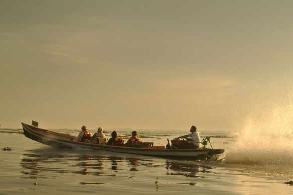 Long boats take us back home.